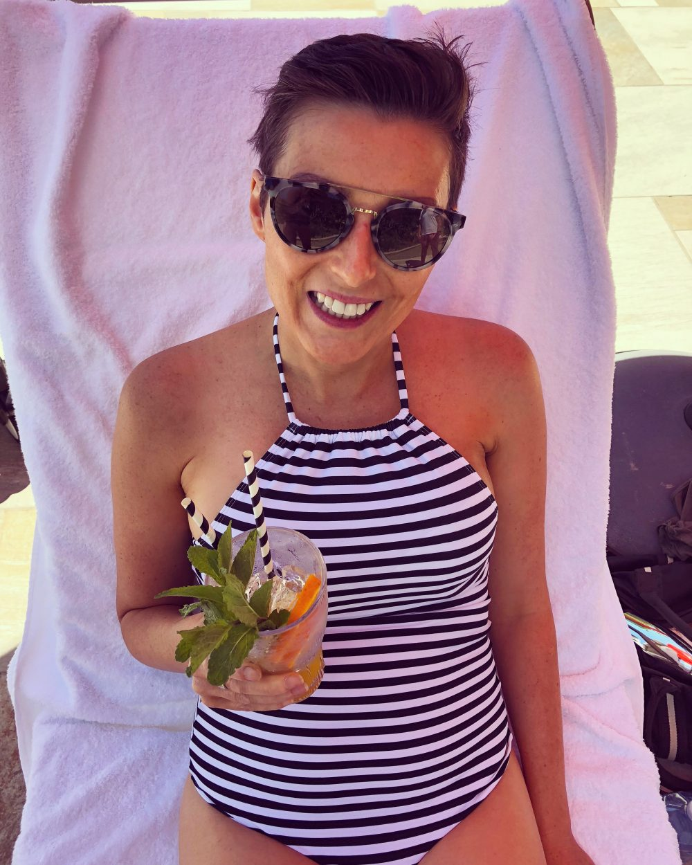 Louise DeCelis drinking a cocktail in Byron Bay